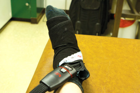 Junior Jordan Estrada of the Sacramento State men's basketball team uses a device called Game Ready to recover from a high ankle sprain he suffered on Dec. 31 against the Weber State University Wildcats.