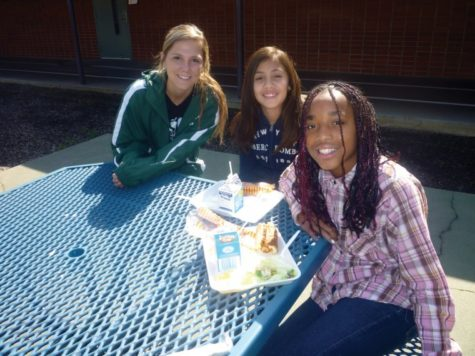 Gabriela Trenton of the Sacramento State women's soccer team eats lunch with children at Howe Elementary.