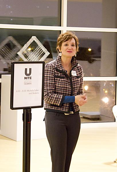 Sacramento State Professor Michelle Felten welcomes visitors to her students' acting performance Thursday night at the Crocker Art Museum.