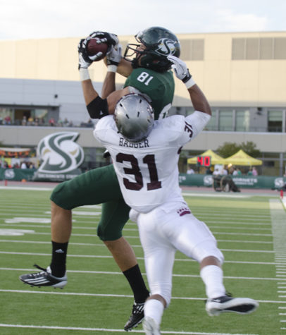 Wide receiver Chase Deadder pulls down a pass for a touchdown during the first quarter of today's game against Montana.