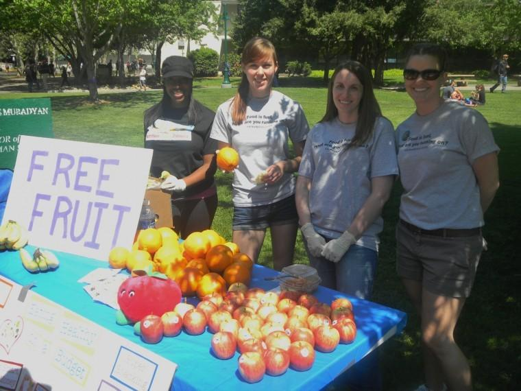 Sac State Food and Nutrition club members - (left to right) junior dietetics major Valerie Turner, senior dietetics major Siena Kriesch, junior dietetics major Tarra Mumma and junior dietetics major Martha Holt - hand out free fruit in the Quad today to raise awareness of their club, food and health.