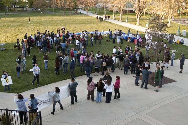 Several students gather outside The Well for a suicide prevention walk, drawings and guest speakers.