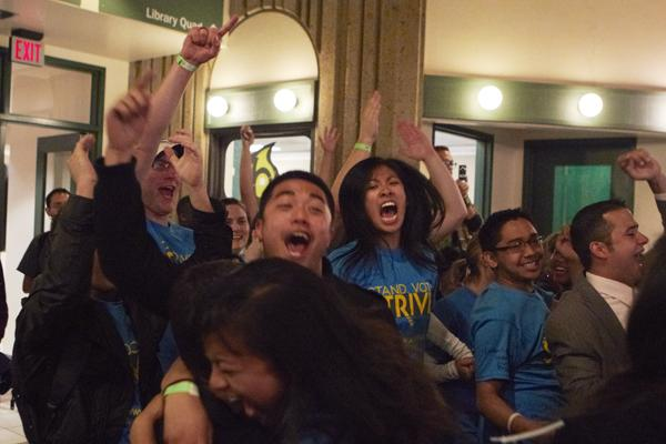 Members of team STRIVE cheer as one of their members gets their name called at the ASI election ceremony. Team STRIVE had more elected officials than the opposing team, Team LEAD.