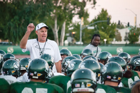 Sacramento State head football coach Marshall Sperbeck gives the team a pep talk during practice on Wednesday. Coming off another upset victory over a Pac-12 Conference team, the Hornets will host the University of Northern Colorado in their home opener on Saturday.