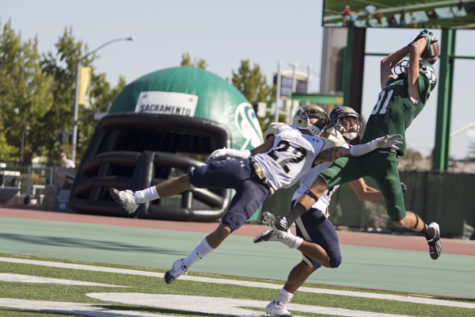Northern Colorado sophomore defensive back Mykel Morse attempts to block a pass to Hornet freshman wide receiver Blake Robertson in Hornet Stadium on Saturday.