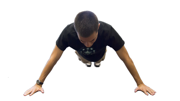 Hornet reporter William Miles demonstrates the starting position of a wide pushup.