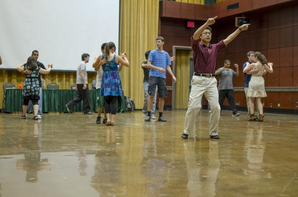 Guest instructor Scott Suwabe directs students in dancing the waltz.