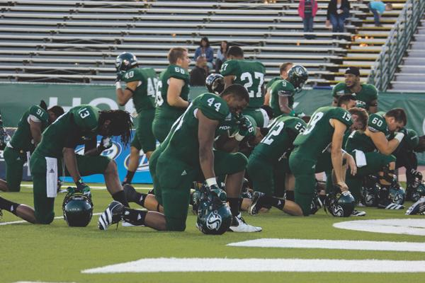 After entering Hornet Field, the players paused for a moment of silence for the loss of their late teammate No. 43 John Bloomfield. Bloomfield passed away Sunday, Oct. 21.