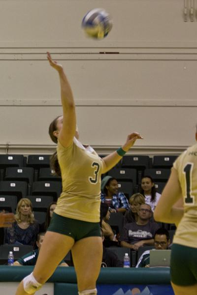 Senior outside hitter Jessie Genger returns the volleyball during the game on Saturday afternoon.