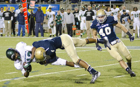 Hornets wide receiver Morris Norrise takes a huge hit from Aggies free safety Aarynn Jones.
