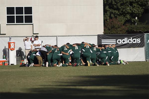 The men's soccer team huddling before the game against UC Davis.