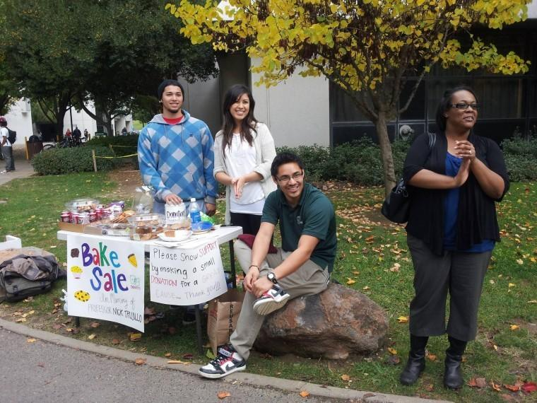 Students from the Small Group Communications class host a bake sale to raise money for the late communication studies professor, Nick Trujillo. From left: Business senior Nick Deis, business junior Ana Aguila, communication studies senior Josh Gonzalez and deaf studies senior Erica West-Oyedele.
