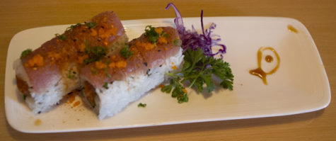 Gail's special is a spicy tuna roll with cucumber and sauce.