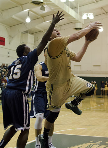 Hornet's Joey Quigley powers to the basket for a shot during tonight's game.