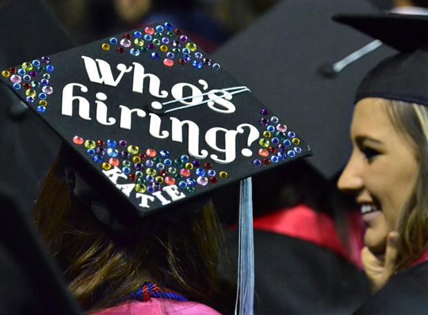Many of the caps of the graduates carried messages, such as the one by Kara Crookston, left, during Fresno State University's 101st Commencement at the Save Mart Center in Fresno, California, on Saturday, May 19, 2012. (John Walker/Fresno Bee/MCT)