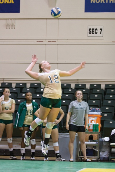 Hornet senior outside hitter Janelle Currey serves the ball in The Nest.