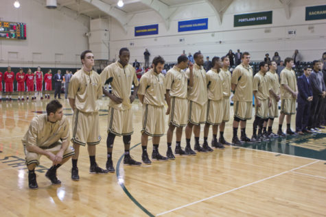 The Hornet basketball team line up before the game against Southern Utah in the Nest wearing their new gold alternate jerseys.