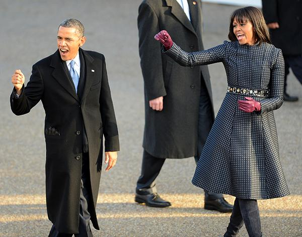 U.S. President Barack Obama and first lady Michelle Obama wave to spectators and supporters on Pennsylvania Ave.near the White House in Washington, D.C., during the Inauguration Parade for Obama's second term, Monday, January 21, 2013. (Chuck Myers/MCT)