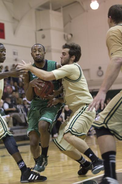 Sac State's Julian Demalleville closely guards North Dakota's Jamal Webb as he drives in the lane.