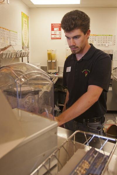 Justin Hamilton, general manager of the Jamba Juice located in the Union, makes a smoothie for a customer.