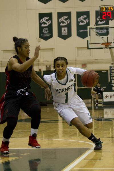 Sophomore guard Fantasia Hilliard dribbles past the defender in her team's 93-86 win against Southern Utah.