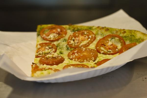 One of Uncle Vito's most popular pizzas is the pesto with slices of tomatoes on top.