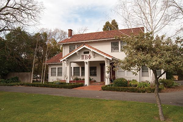 Pi Beta Phi with a neatly mowed lawn across the street from UCD.