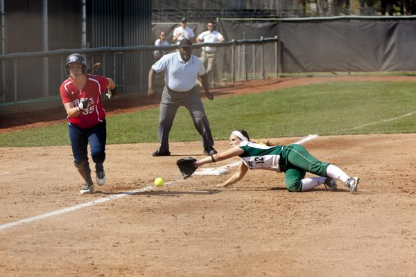 Hornet senior third baseman No. 12, Emily McCormick, makes a diving stop in the second inning against St. Mary's on Saturday during the Capital Classic Tournament.