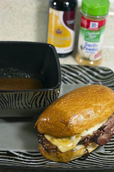 Dip the warm sandwich into the savory Au Jus for more flavor.