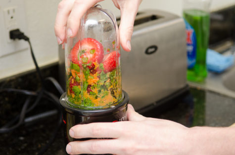 Place your fruit in the blender. Be prepared to refill your blender a few times to fit in all the ingredients.