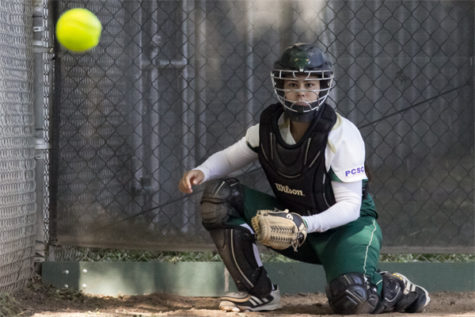 Hornet sophomore catcher No. 9 Kortney Solis warms up fo their game against Weber State on Friday in the bullpen at Shea Stadium.