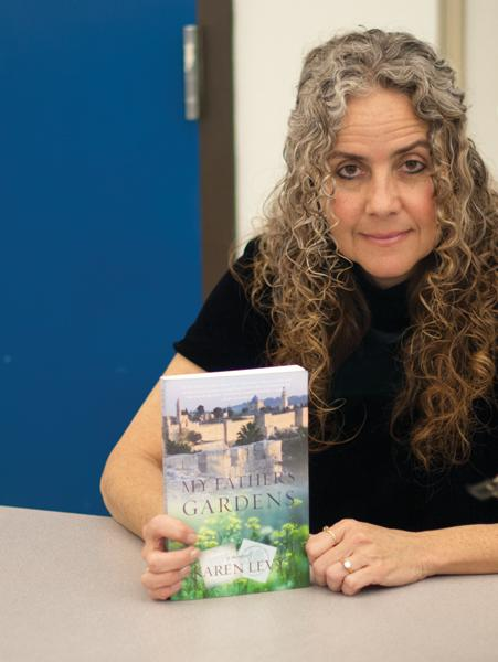 Professor of English Karen Levy gets her book My Fathers Garden published.