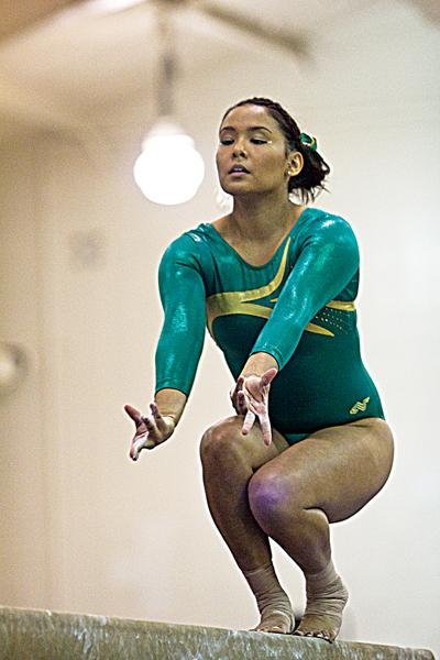 Elideth Guerrero poses to begin her turn on the beam during the meet against the Air Force Falcons on Sunday. Guerrero scored a 9.675 on the beam.