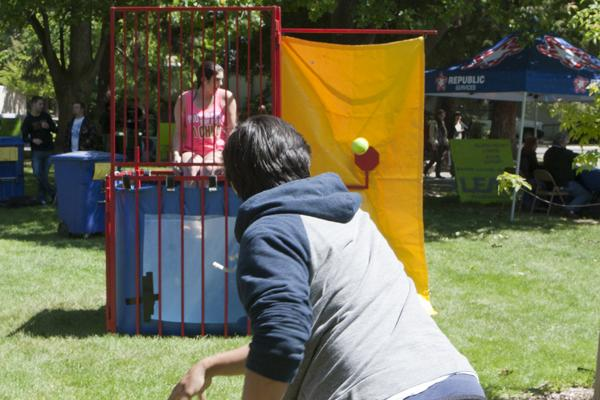 Alpha Chi Omega President Katie Dillen waits to be dunked as sophomore civil engineer Jason Estrella makes a throw on Wednesday for the Earth Day events in the Library Quad.