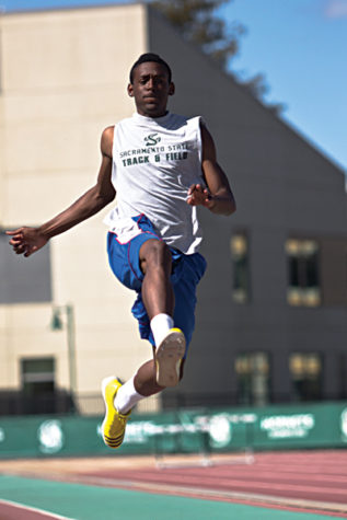Londeen McCovery performs a long jump during the Hornet's track and field practice in the Hornet Stadium on April 2.