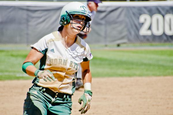 Hornet sophomore outfielder No. 2 Paige Martin runs past third base as she heads for home to score against Idaho State at Shea Stadium.