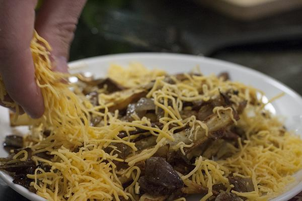 The perfect animal style fries consists of a lot of shredded cheese.