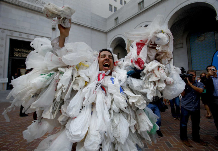 James Alamillo works up the crowd at a rally staged before the LA City Council vote to ban plastic bags in Los Angeles, California, on May 23, 2012 (Mark Boster/Los Angeles Times/MCT)