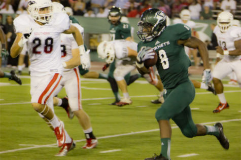 Sac State Hornet running back Ezekiel Graham No. 8 runs through Southern Oregon's defense for a first down on Saturday night.