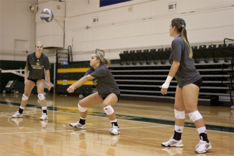 Hornet freshman outside hitter No. 3 Morgan Stanley runs through a drill today during practice in the Hornet's Nest.