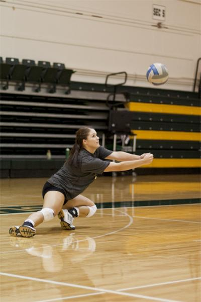 Hornet freshman middle blocker No. 2 Courtney Dietrich dives for the ball at practice in the Hornet's Nest.