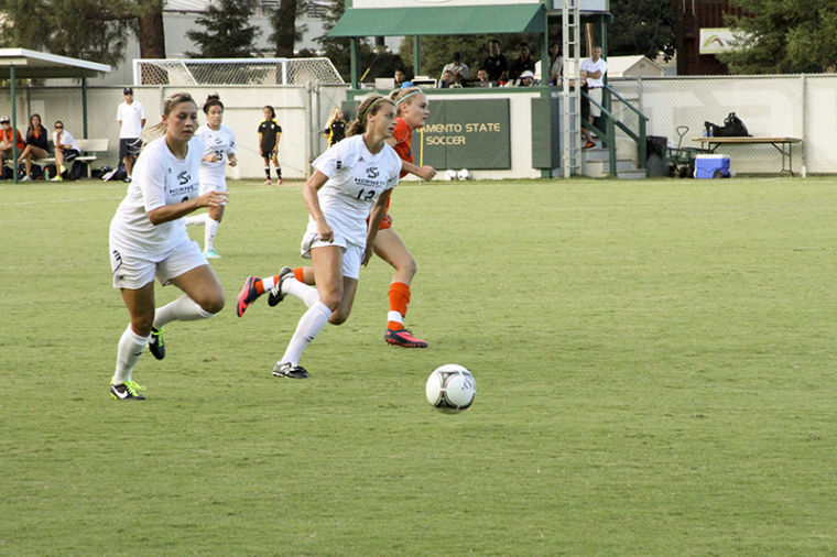 Sac State defenders, junior No. 12 Kassi Anast and sophomore No.8 Mckenna Swanson work together to defend the goal at Wednesdays game against Fresno Pacific.