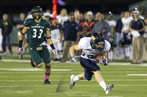 A Northern Arizona Lumberjack gets away from Hornet freshman defensive back No. 33 Nick Crouch at Hornet Stadium on Saturday.