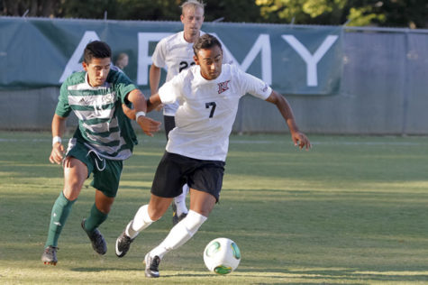 Junior midfielder No.13 Andres Garcia works to steal the ball from Cal State Northridge senior forward No.7 Beto Velasquez in the Oct. 4 game at Hornet Field.