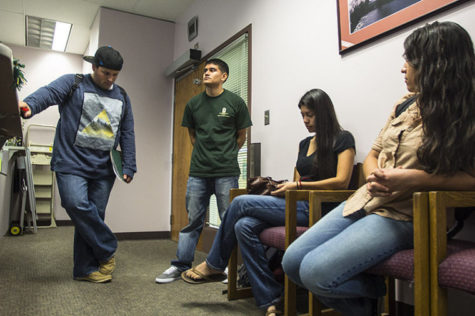 Students (left to right) Trevor Garcia-Neeley, Rodolfo Rodriguez, Victoria Ordorica-Yenez and Denise Fernandez wait outside Friday's Student Fee Advisory Committee closed meeting in Lassen Hall.