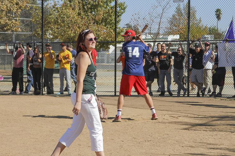 Grandslam chair and Criminal Justice senior Erys Melendez walks across the field as different fraternities and sororities compete in a home run derby.