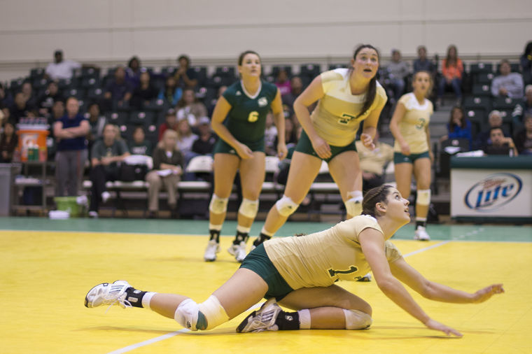 Senior+opposite+hitter+No.+13+Kayla+Beal+watches+the+ball+after+diving+to+the+floor+at+the+game+against+the+Idaho+State+Bengals.