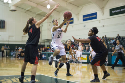 Junior guard No. 32 Andrea Chenier attempts to score against Cal State Northridge at the Nest.