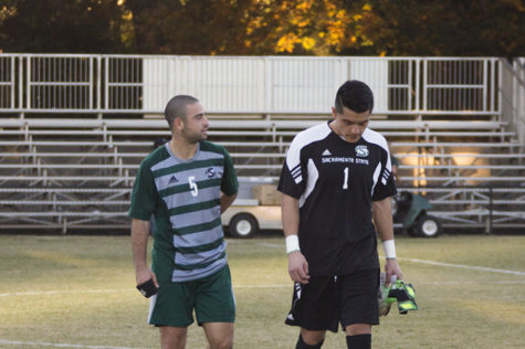 No. 5 senior midfielder Almog Strikowski and No. 1 senior goalkeeper Cesar Castillo walk off the field together after their last game as Sacramento State soccer players, on Saturday against UC Davis.