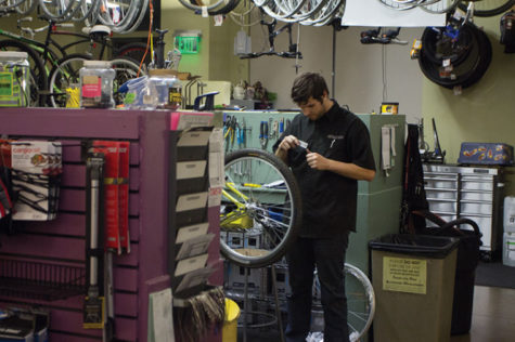 Alex Hegarty, a Peak Adventures mechanic, prepares a bicycle for his bike maintenance class on Nov. 7.